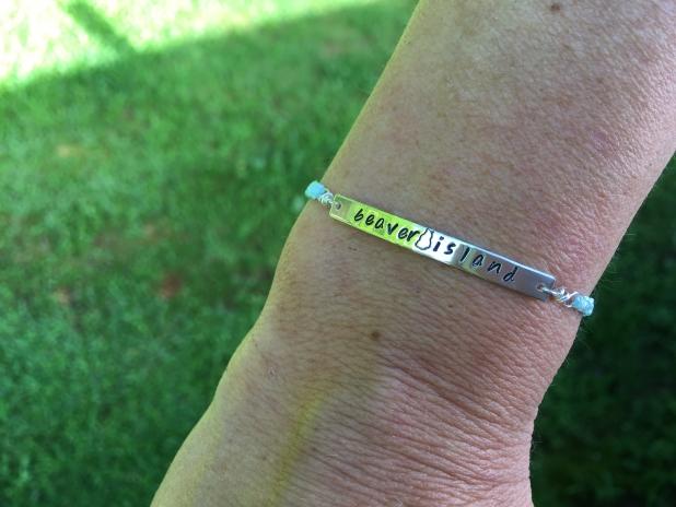 Metal stamped nylon cord bracelet