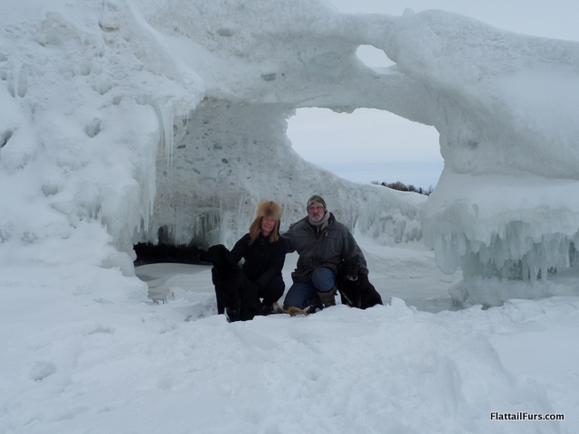 Mark, Laura, Porter, and Jetta in front of an ice cave on Beaver Island, MI.